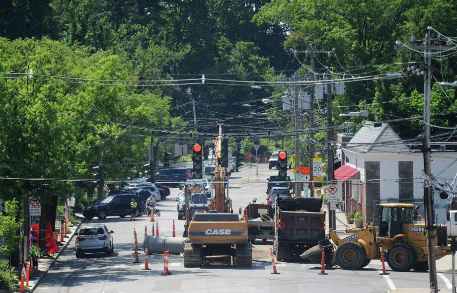 Construction workers guide traffic down a single lane on Sound Beach Avenue as they work in Old Greenwich. Photo: Tyler Sizemore / Hearst Connecticut Media / Greenwich Time