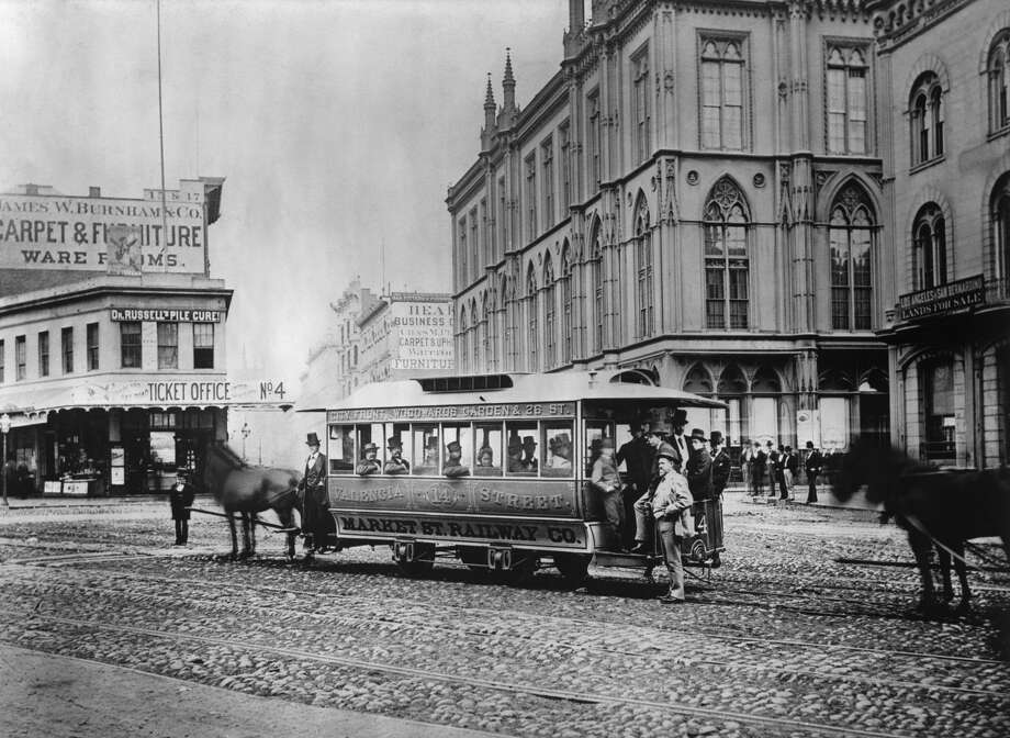 Before cable cars were introduced, street cars were dragged by horses as seen in this 1880 file photo at Market, Post and Montgomery Streets. The first cable car was introduced in 1873 on Clay Street and due to it's success, more cable car lines spread throughout the city. Photo: Bettmann/Bettmann Archive