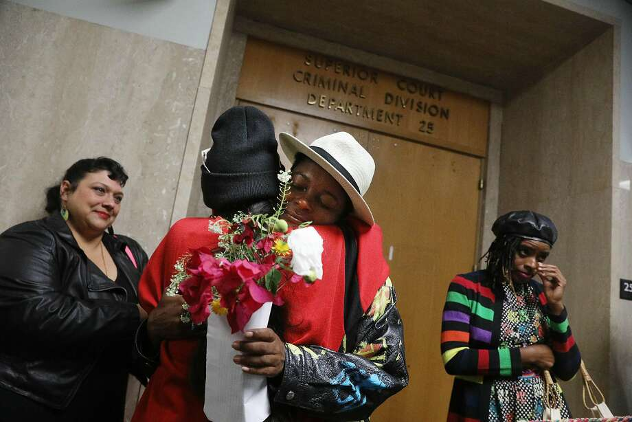 Rape survivor Amber (in light-colored hat) is hugged by her cousin Little M Vila after reading her statement in court. Photo: Lea Suzuki / The Chronicle