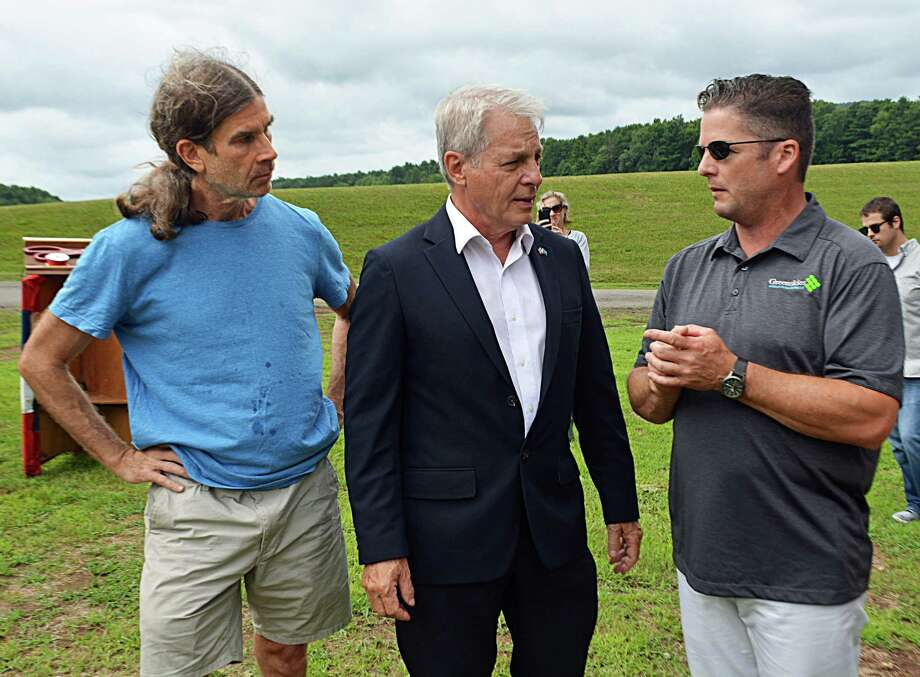 From left, Jeff Hush, member of the city's Clean Energy Task Force; state Sen. Len Suzio, R-Meriden; and James Desanatos, vice president of Business Development & Government Relations at Greenskies Renewable Energy of Middletown; gathered Thursday to inaugurate the solar array installed in June on city property adjacent to the Higby Water Treatment Facility on the Middletown line. Photo: Cassandra Day / Hearst Connecticut Media