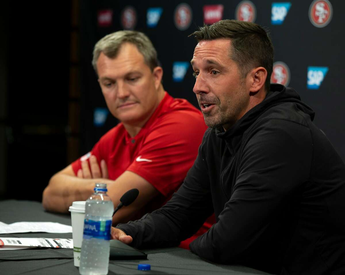 San Francisco 49ers General Manager John Lynch, left, and Head Coach Kyle Shanahan speak to the media on the first day of the team's training camp, Wednesday, July 25, 2018 in Santa Clara, Calif.