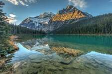 Reflection of Mount Edith Cavell at sunrise in Jasper National Park, Alberta, Canada.