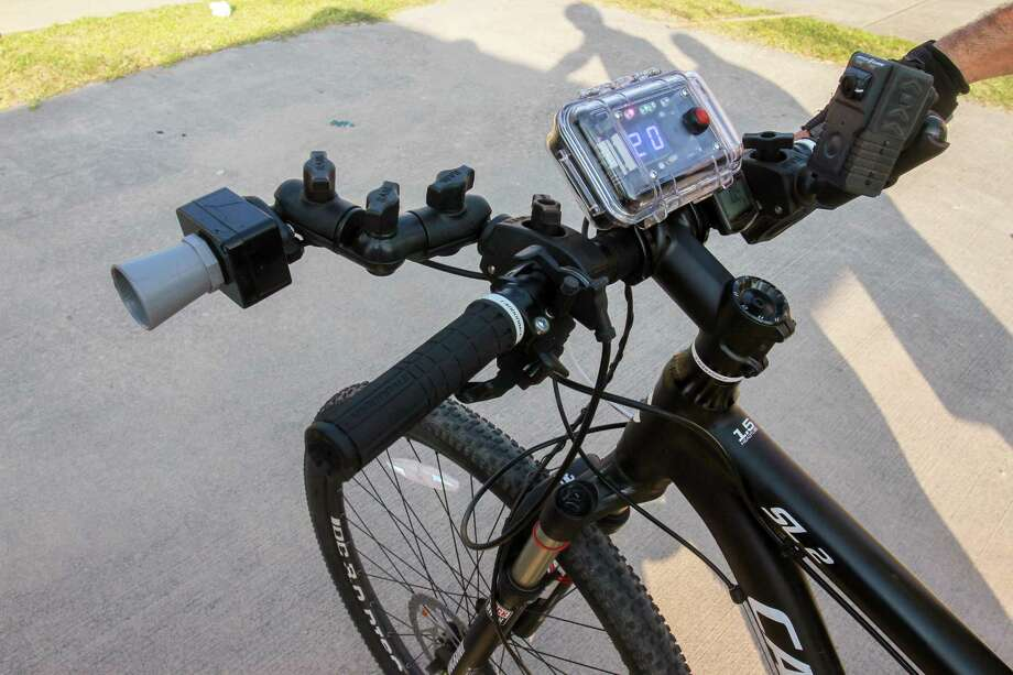 The C3FT unit, mounted on the bicycle's handlebars, records distance of passing motorists from the bicycle. The sensor on the left, reads the distance and the unit on the right shows the distance of the passing vehicle from the bike's handlebars. The system also has a camera that records a photo of the passing vehicle. HPD demonstrated the unit which will be used to help enforce the Safe Passing ordinance. Photo: Gary Fountain, Contributor / Houston Chronicle / © 2018 Gary Fountain