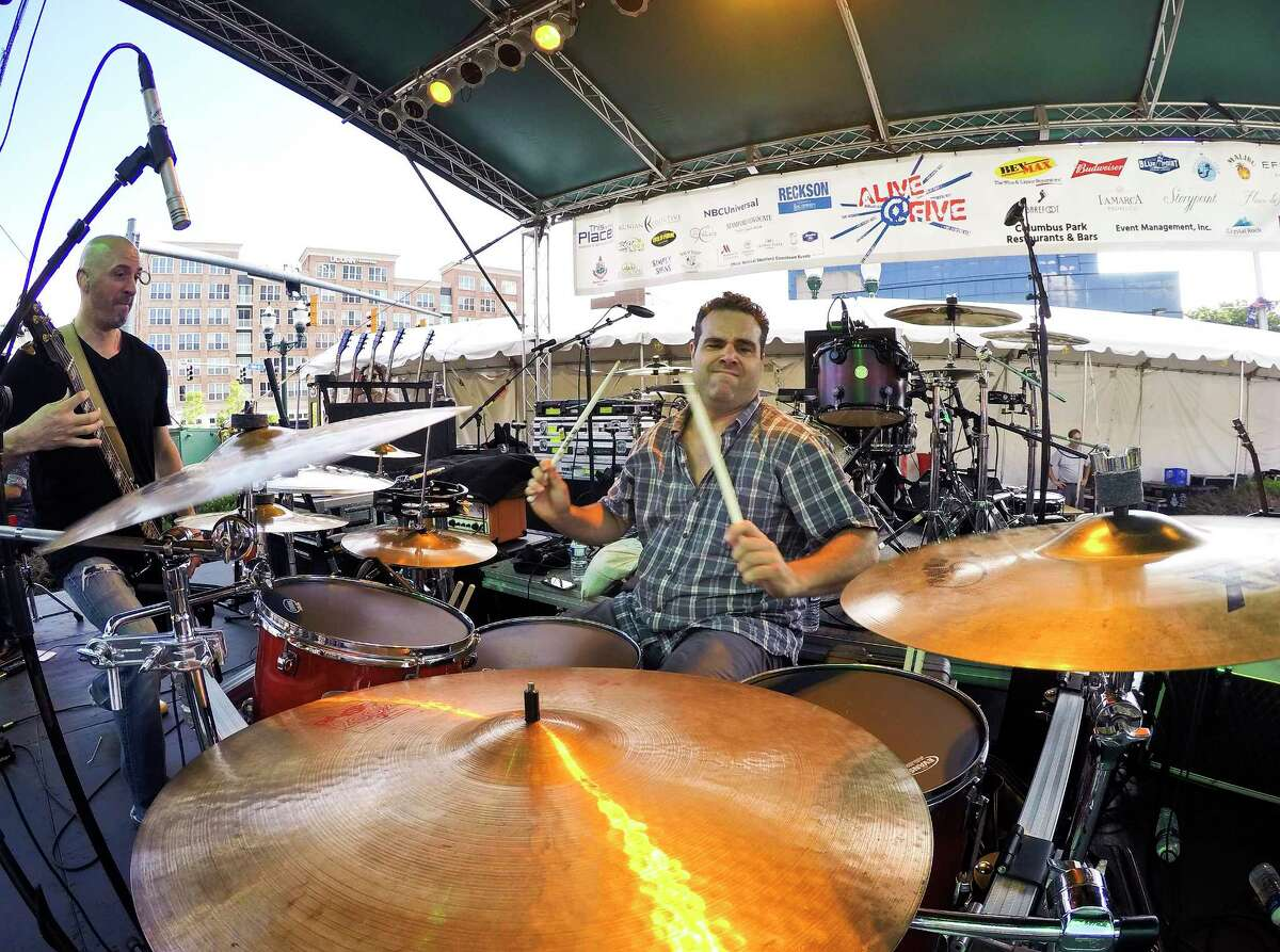 Jared Vergilis, drummer for the Sean Austin Band who is from Ridgefield plays during the opening of the Alive@ Five concert series for headliner Lifehouse at Columbus Park on July 26, 2018 in Stamford, Connecticut.