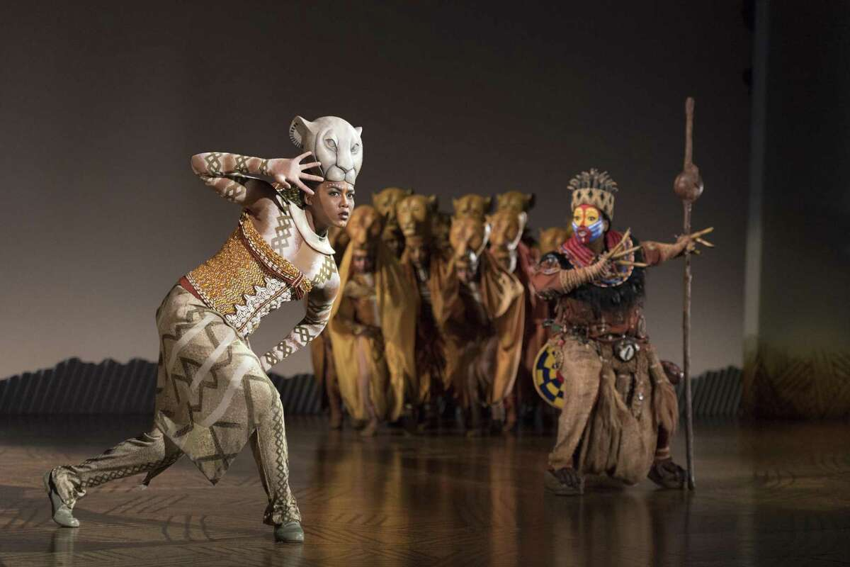 """Nia Holloway as Nala, Buyi Zama as Rafiki and The Lionesses in """"The Lion King."""""""