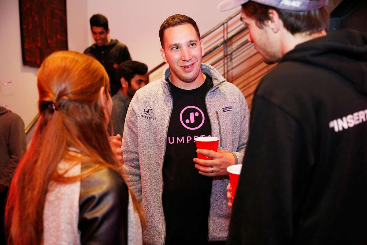 Jumpstart founder and CEO Ben Herman (center) during a Jumpstart launch party at the Pearl venue on Friday, July 20, 2018, in San Francisco, Calif. Jumpstart celebrated the release of their AI-powered recruiting app.