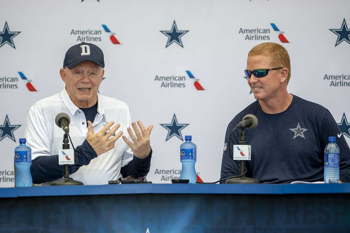 Dallas Cowboys owner Jerry Jones, left and head coach Jason Garrett take questions from the press during the