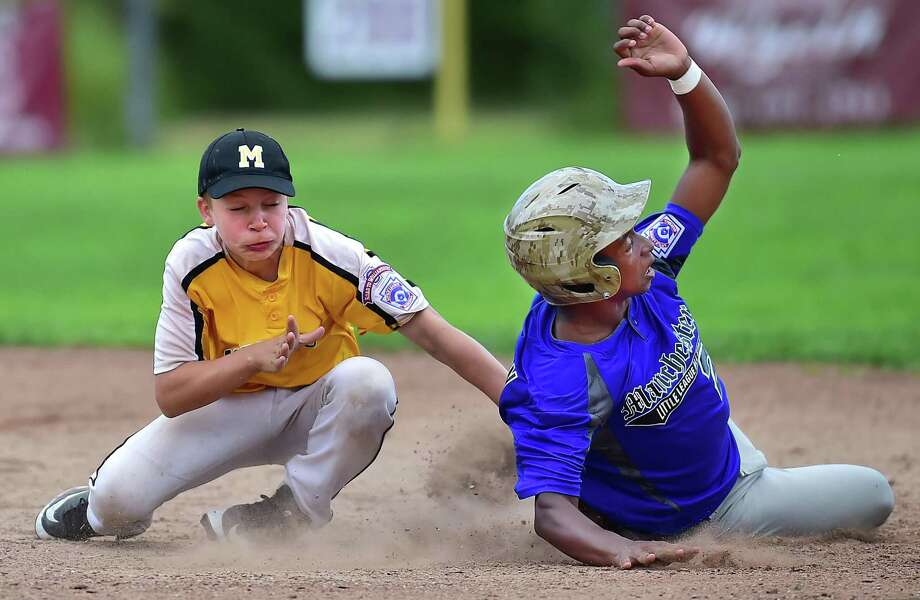 Madison shortstop Ben Kuja tags out Manchester National's Stew Harrison in the Little League state championship tournament on Thursdayin East Lyme. Photo: Catherine Avalone / Hearst Connecticut Media / New Haven Register