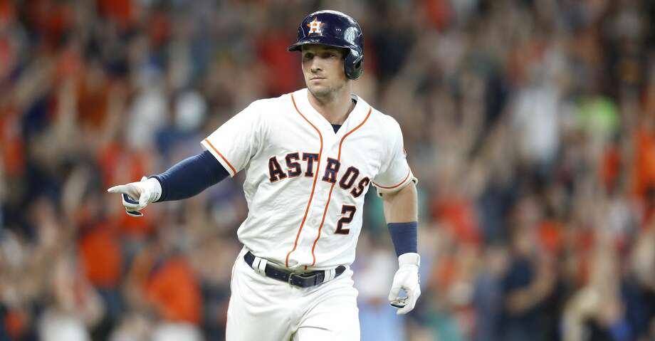 Houston Astros third baseman Alex Bregman (2) points to the Astros' dugout after connecting for a two-run home run, bringing in Houston Astros second baseman Tony Kemp (18) and winning the game for the Houston Astros 7-6 in the bottom of the ninth inning at Minute Maid Park on Wednesday, June 27, 2018 in Houston.  (Elizabeth Conley/Houston Chronicle) Photo: Elizabeth Conley/Houston Chronicle