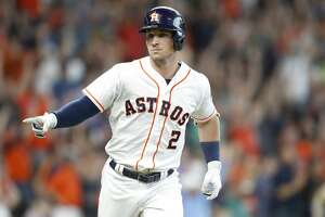 Houston Astros third baseman Alex Bregman (2) points to the Astros' dugout after connecting for a two-run home run, bringing in Houston Astros second baseman Tony Kemp (18) and winning the game for the Houston Astros 7-6 in the bottom of the ninth inning at Minute Maid Park on Wednesday, June 27, 2018 in Houston.  (Elizabeth Conley/Houston Chronicle)