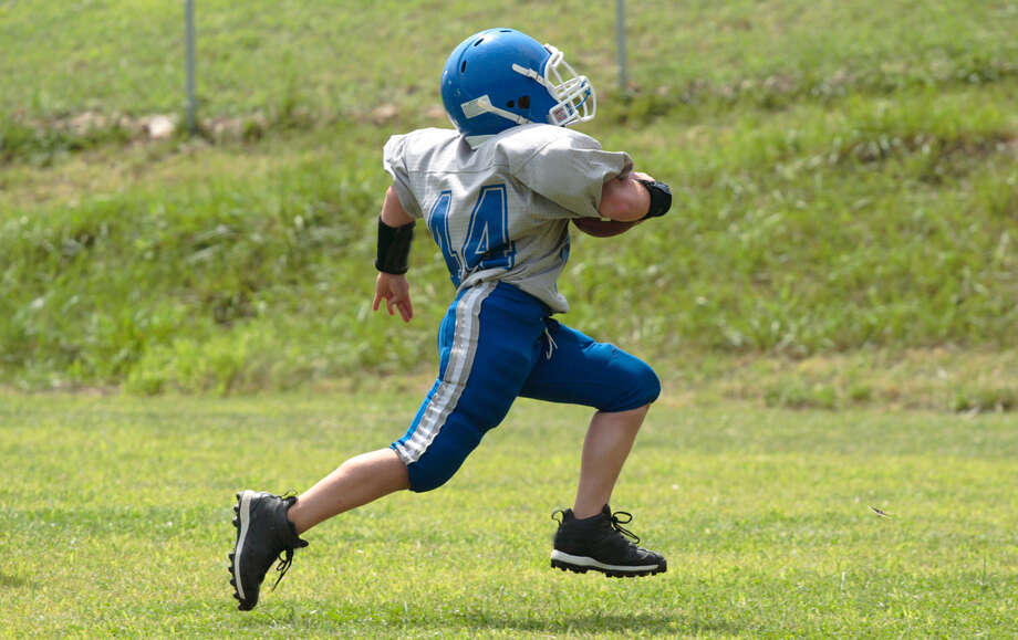 Fishing vests, football jerseys, and school and work uniforms are exempt. While sportswear is exempt — for instance jerseys and golf shirts — sports shoes like cleats for football are taxable. Photo: Shutterstock