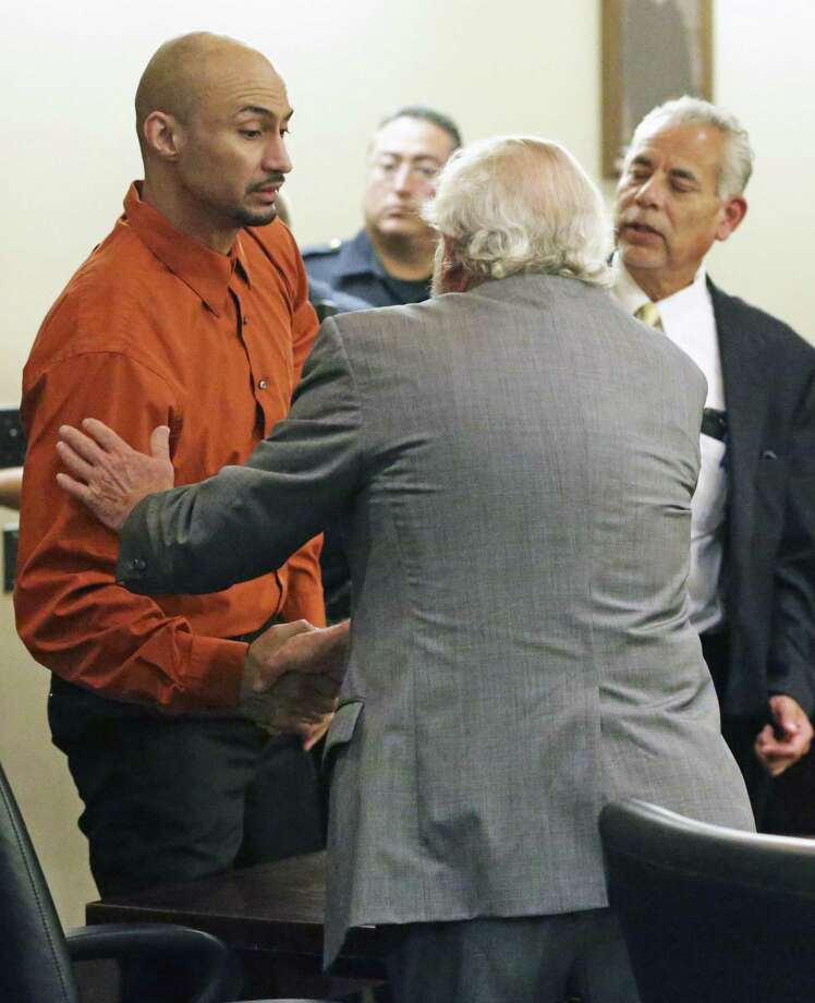 Luis Antonio Arroyo shakes hands with his attorney Raymond Fuchs (foreground) and Joel Perez on a mistrial at his murder trial in the 227th District Court presided over by Judge Kevin O'Connell on July 26, 2018. Photo: Photos By Tom Reel / Staff Photographer / 2017 SAN ANTONIO EXPRESS-NEWS