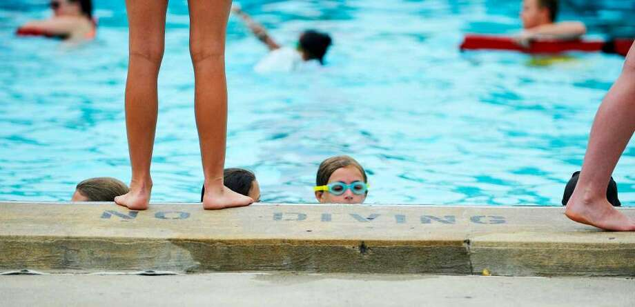 Children take free swimming lessons, offered by the state Office of Parks, Recreation and Historic Preservation, at the Tawasentha Park pool house. (Paul Buckowski / Times Union archive)