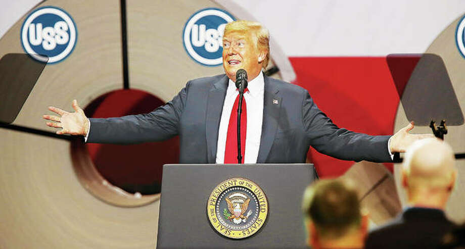 President Donald Trump makes gestures while speaking to a crowd of mostly steelworkers Thursday at the U.S. Steel Corp.'s Granite City Works, in Granite City. Trump was accompanied by a few members of his cabinet, including Department of Commerce Secretary Wilbur Ross and Department of Labor Secretary Alex Acosta along with daughter Ivanka Trump, while he spoke about the tariffs he imposed on foreign steel and how they are helping facilities like Granite City Works. Photo:       Photos By John Badman | The Telegraph