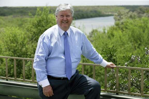 Dennis Nixon, International Bancshares Corp.'s chairman, CEO and president, stands on a deck at the Laredo-based company's Lago park overlooking the Rio Grande. Nixon opposes a border wall to address illegal immigration. He favors cleaning up the river and adding more immigration judges.