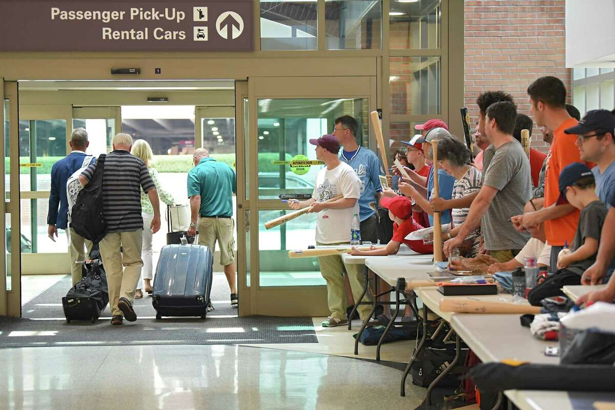 Former baseball player George Brett and his wife Leslie are seen walking past autograph seekers with their luggage at Albany International Airport before heading to Hall of Fame weekend at Cooperstown on Thursday, July 26, 2018 in Colonie, N.Y. Brett didn't sign one autograph. (Lori Van Buren/Times Union)