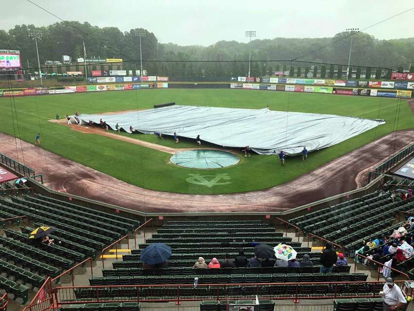 Ground crews cover the infield with a tarp during a rain delay as the Tri-City ValleyCats play the Aberdeen IronBirds during a minor league baseball game Thursday, July 26, 2018, in Troy, N.Y. (Hans Pennink / Special to the Times Union)