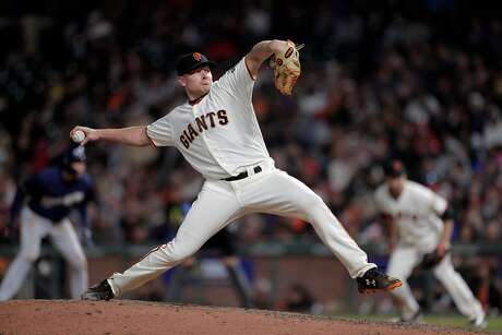 Mark Melancon pitches in the top of the eighth inning as the San Francisco Giants played the Milwaukee Brewers at AT&T Park in San Francisco, Calif., on Thursday, July 26, 2018. Photo: Carlos Avila Gonzalez / The Chronicle