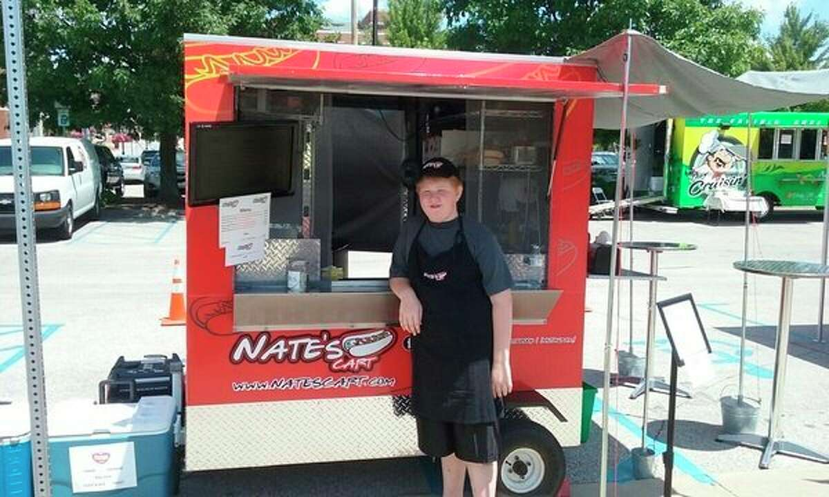 Nate Surbrookoperates Nate's Cart, which features Koegel hot dogs. Currently, the 12-year-old is at the Midland Area Farmer's Market on Wednesdays and Saturdays. (John Kennett/jkennett@mdn.net)