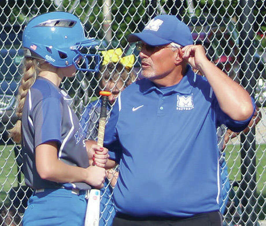 Marquette Catholic coach Dan Wiedman talks with Jada Johnson before her plate appearance during a game in the Explorers 36-2 season that earned Wiedman honors for 2018 Telegraph Small-Schools Softball Coach of the Year. Photo:       Greg Shashack / The Telegraph