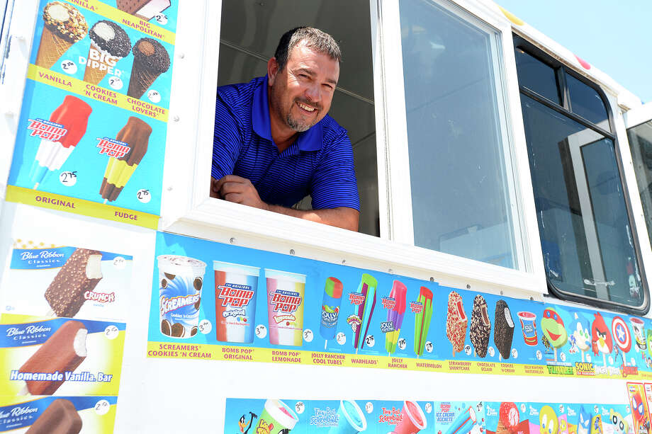 Keith Doucet started his ice cream truck to give his sons a hands-on education on running a business. The boys run the sales window while he drives the truck. Photo taken Thursday 7/26/18 Ryan Pelham/The Enterprise Photo: Ryan Pelham/The Enterprise / ?2018 The Beaumont Enterprise