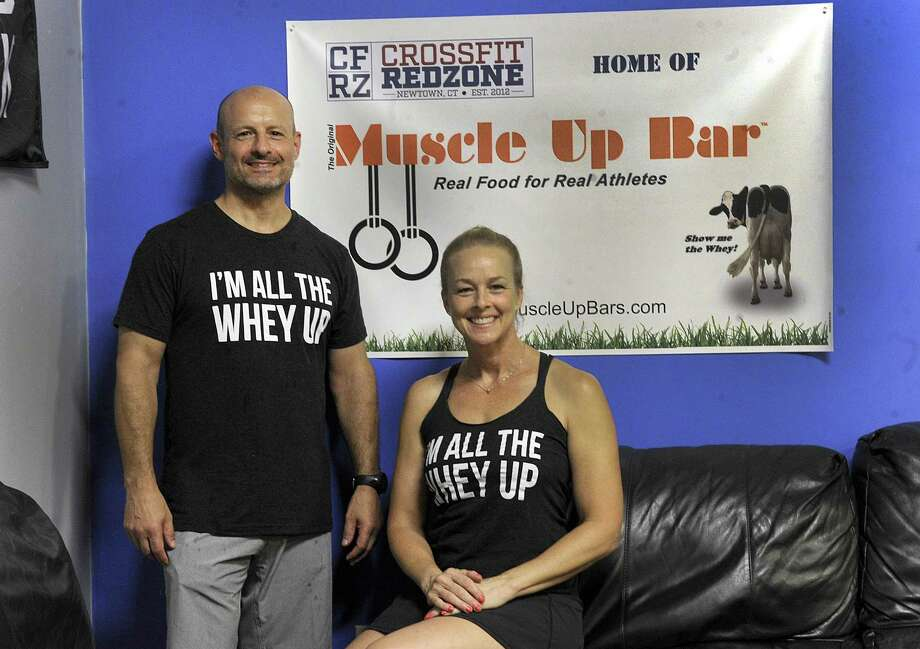 Tony Leonardi, left, of Newtown and Lori Aleks, of Weston, are owners and founders of MuscleUp Bars. Photo Tuesday, July 17, 2018. Photo: Carol Kaliff / Hearst Connecticut Media / The News-Times