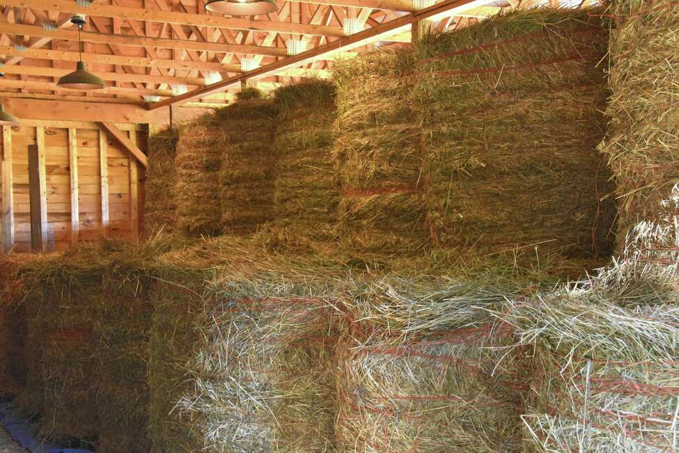FILE - Bales of hay on Wednesday, July 18, 2018 in West Sand Lake, N.Y.
