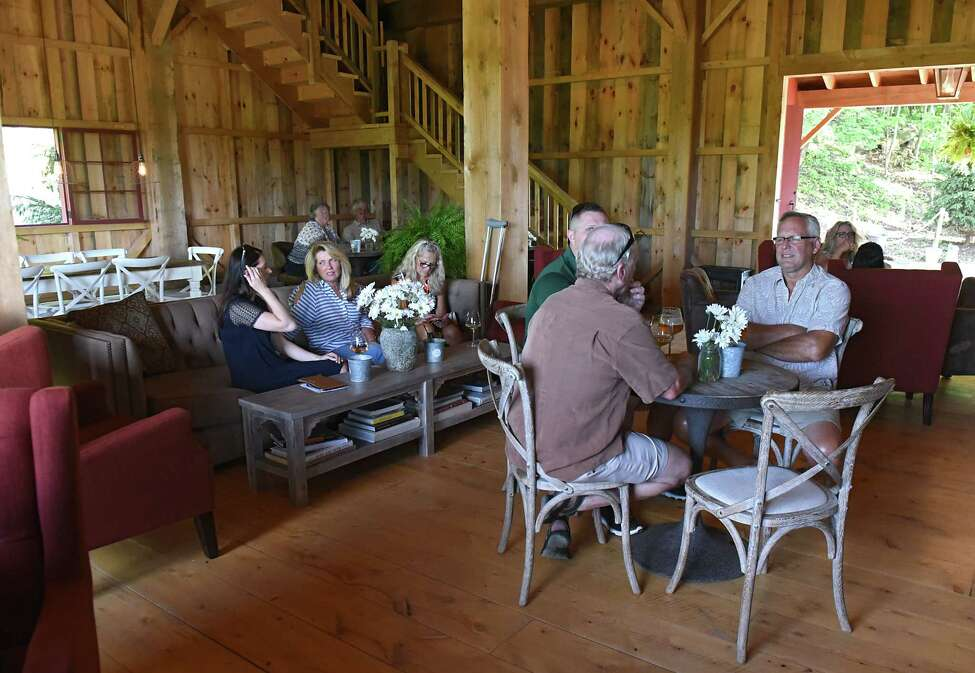 People enjoy food and cocktails in the Pony Barn cocktail lounge and restaurant at June Farms on Wednesday, July 18, 2018 in West Sand Lake, N.Y. June Farms is owned by Matt Baumgartner. (Lori Van Buren/Times Union)
