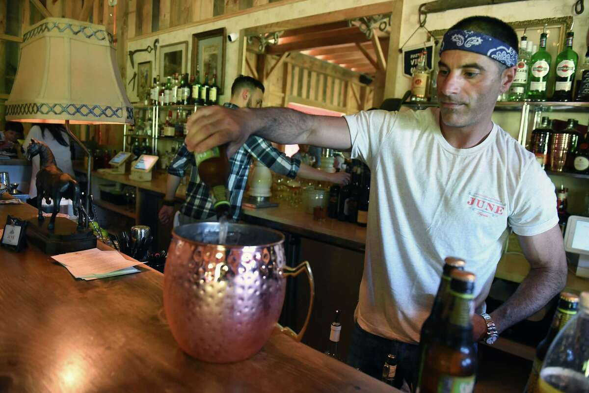 Owner Matt Baumgartner pours a birthday mule drink in the Pony Barn cocktail lounge and restaurant at June Farms on Wednesday, July 18, 2018 in West Sand Lake, N.Y. (Lori Van Buren/Times Union)