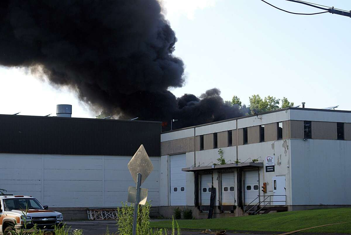 A roof-top solar panel array caught fire Thursday evening in southern Danbury, sending plumes of thick black smoke into the air that were visible for miles.