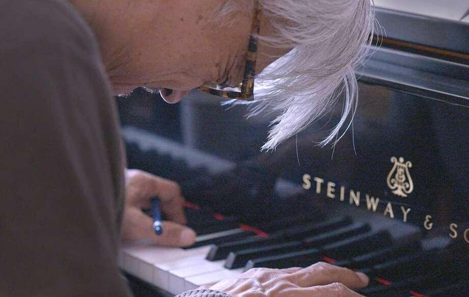 """Ryuichi Sakamoto in the documentary """"Ryuichi Sakamoto: CODA."""" Photo: MUBI"""