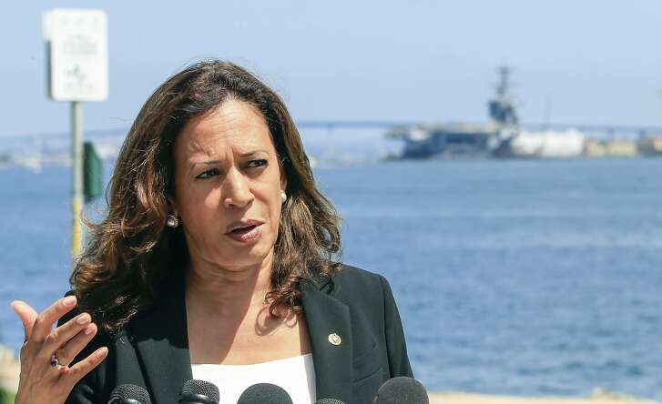 Standing on Harbor Island, U.S. Sen. Kamala Harris, D-Calif., speaks to the press about her recent tour of Naval Base Point Loma on Friday, July 20, 2018, in San Diego, Calif.  (Eduardo Contreras/The San Diego Union-Tribune via AP)