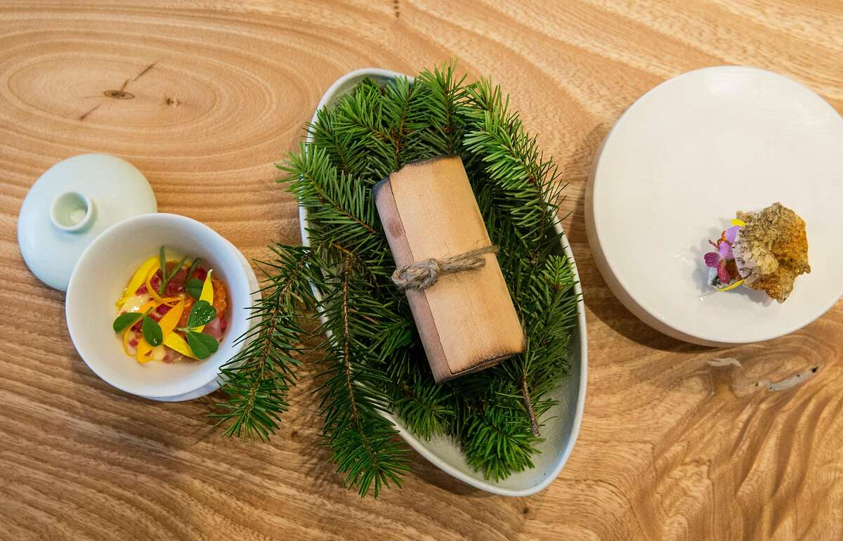 (From left) Creek raised trout custard made with dried bones and scraped belly meat, skin & roe with horseradish mayonnaise, and trout warmed in cedar, cured and smoked photographed at Birdsong in the South of Market district of San Francisco, Calif. Tuesday, July 24, 2018.