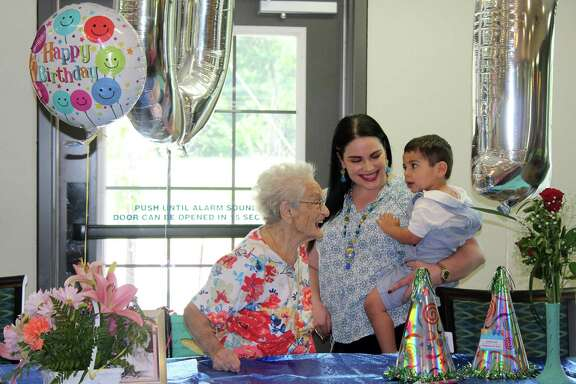 Bertha Caplan is joined by her granddaughter and great-grandson on her 101st birthday at Fall Creek Rehab and Healthcare Center in Atascocita on Thursday, July 26.