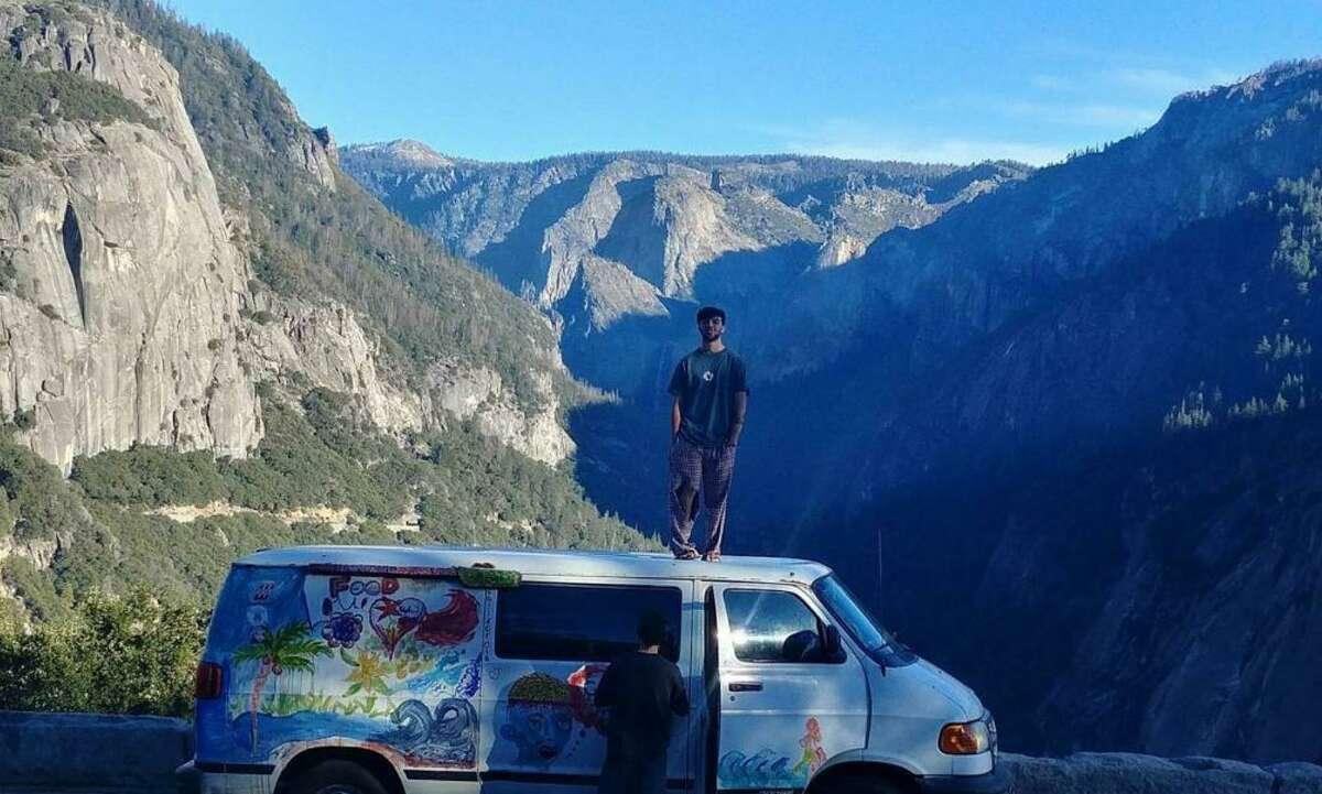 Bodhi Goncharoff on top of his van.