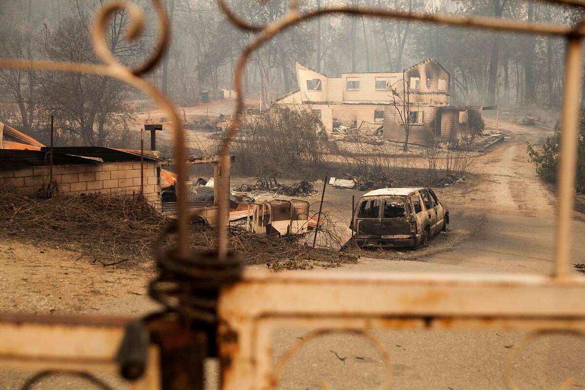 A burned-out house is seen along Lower Spring Road after the Carr Fire raced toward downtown Redding.