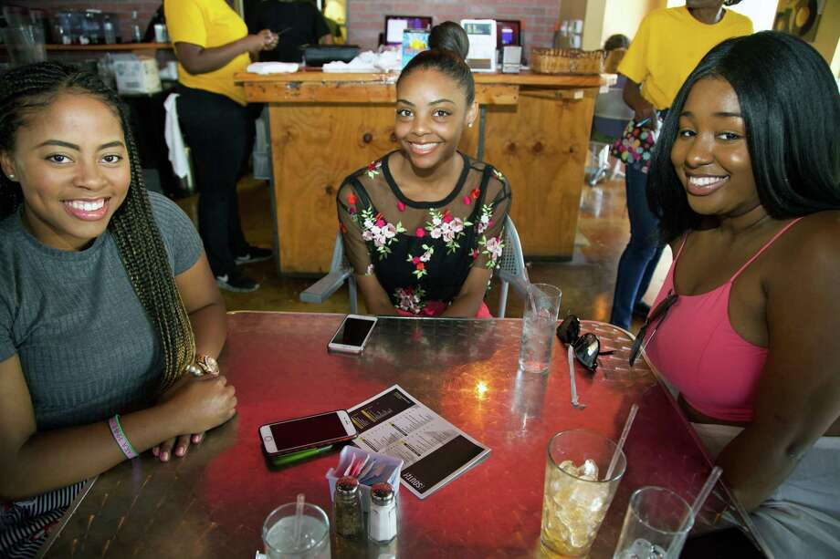 Halli Jolly, Novate Creeks and Rachel White get together at The South Chicken & Waffles. Photo: Xelina Flores /Contributor