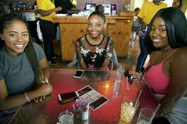 Halli Jolly, Novate Creeks and Rachel White get together at The South Chicken & Waffles.
