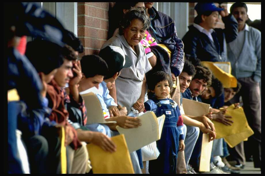 BROWNSVILLE, UNITED STATES - FEBRUARY 01:  Refugees from Central American on line outside INS processing center awaiting outcome of their status , after applying for political asylum.  (Photo by Shelly Katz/The LIFE Images Collection/Getty Images) Photo: Shelly Katz/The LIFE Images Collection/Getty Images