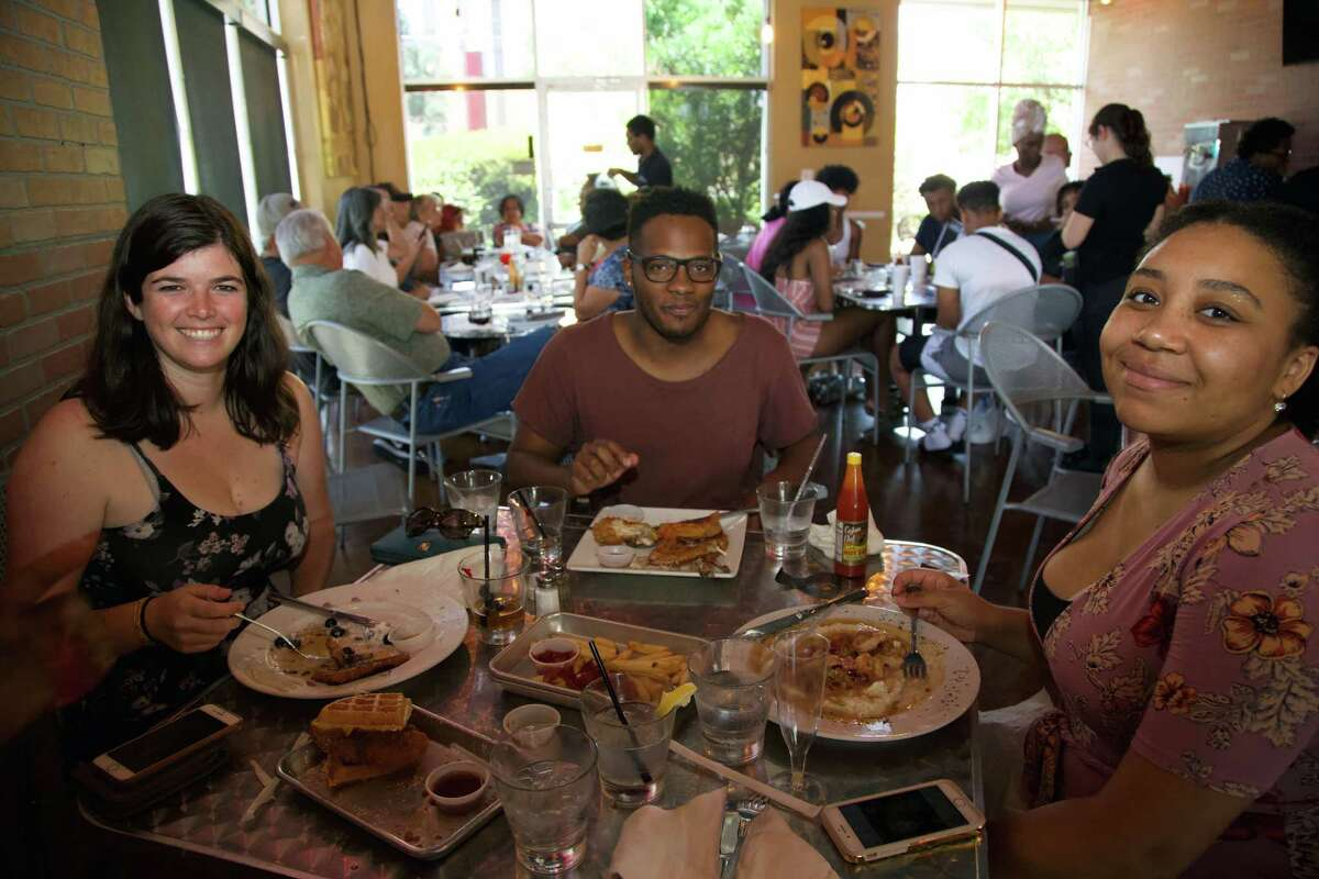 Marcea McGuire, Sydell Brook and Chloe Colder enjoy a meal at The South Chicken & Waffles.