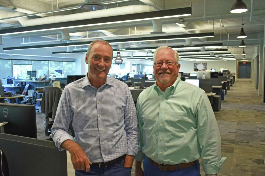 Remedy Partners founder Steve Wiggins, left, alongside CEO Chris Garcia on July 24, 2018, at the health insurance company's headquarters in Norwalk, Conn. Photo: Alexander Soule / Hearst Connecticut Media