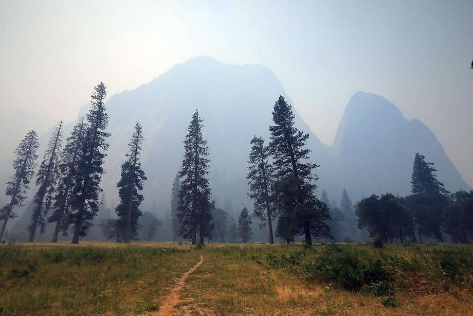 Thick smoke blankets Yosemite Valley in California's Yosemite National Park, July 26, 2018. Thousands of tourists were evacuated a day earlier, as one of the country's most iconic natural preserves was blanketed with thick smoke from a 38,000-acre fire. (Jim Wilson/The New York Times) Photo: JIM WILSON / NYT