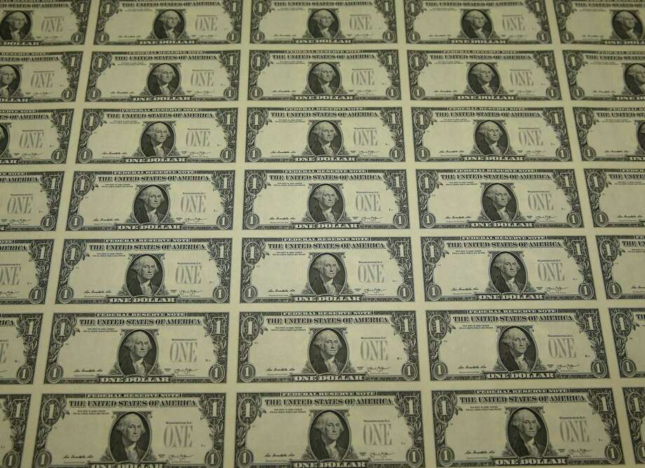 A sheet of freshly printed one dollar bills is ready for inspection at the Bureau of Engraving and Printing on March 24, 2015 in Washington, DC. Banks are aggressively courting customers with CDs, an American staple that fell out of favor. Some $1.7 trillion sat in FDIC-insured CDs during the first quarter — the highest amount in nearly six years. Photo: Mark Wilson /Getty Images / 2015 Getty Images