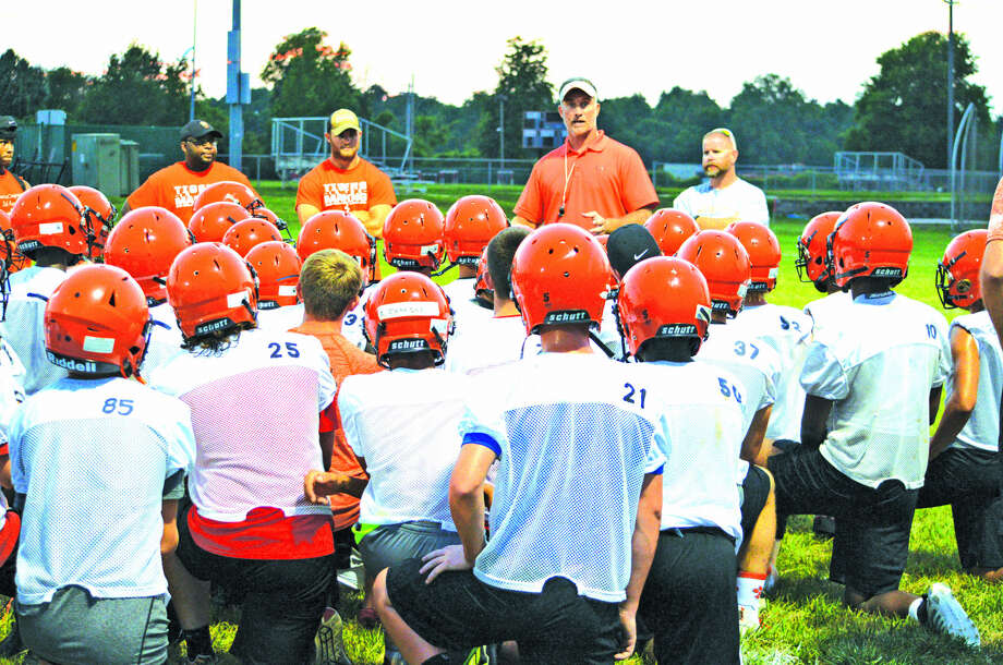 Edwardsville coach Matt Martin talks to his team after Monday's 7-on-7 scrimmages at EHS. It was the final set of 7-on-7 scrimmages for the Tigers this summer. Photo: Scott Marion