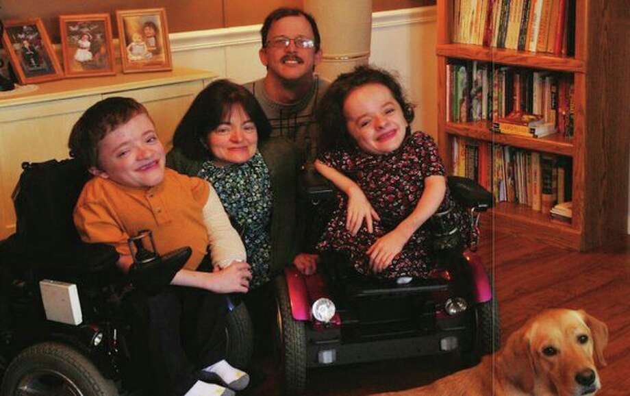 The Davert Family. Missy Davert, center, will speak at the upcoming Disability Awareness Conference Aug. 1 in Saginaw. She was executive director at The Center for Independent Living in Midland, where she worked for 13 years. (photo provided)