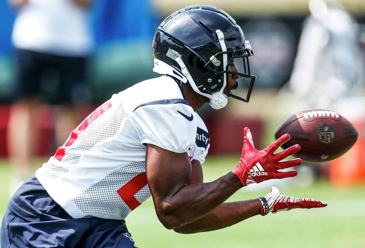 Houston Texans running back Tyler Ervin (21) makes a catch during training camp at the Greenbrier Sports Performance Center on Friday, July 27, 2018, in White Sulphur Springs, W.Va.