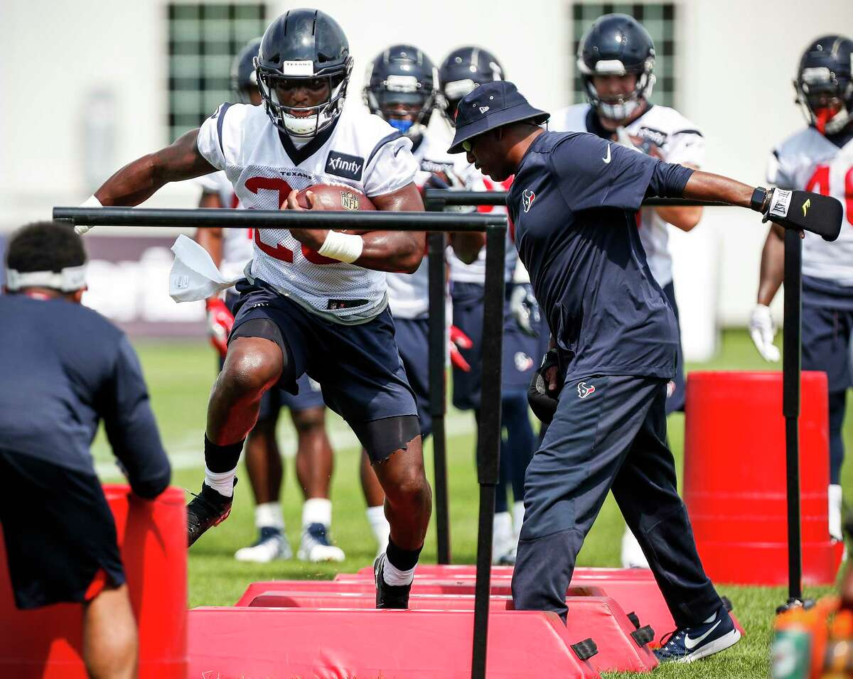 Houston Texans running back Alfred Blue (28) runs with the football through a set of obstacles during training camp at the Greenbrier Sports Performance Center on Friday, July 27, 2018, in White Sulphur Springs, W.Va.