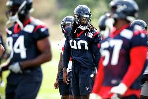 Houston Texans defensive end Jadeveon Clowney (90) warms up during training camp at the Greenbrier Sports Performance Center on Friday, July 27, 2018, in White Sulphur Springs, W.Va.