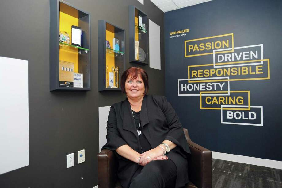 Synchrony Financial CEO and President Margaret Keane poses for a photo inside Synchrony headquarters on Long Ridge Road in Stamford, Conn., on Nov. 27, 2017. Photo: Michael Cummo / Hearst Connecticut Media / Stamford Advocate