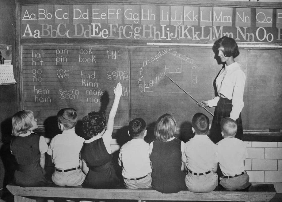 This file photo shows former Bad Axe kindergarten teacher Sharon Radlinski teaching students while at Nazareth College in Kentucky. Photo: Courtesy Photo
